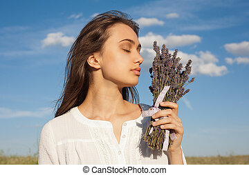 Scent of lavender. - Portrait of a young brunette beauty...