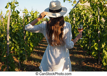 Gorgeous brunette woman having wine fun. - Portrait of a...