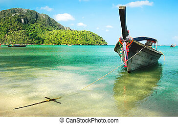 Phi Phi Boat - Wooden boat moored on the beach of the island...