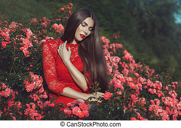 Woman among the roses.