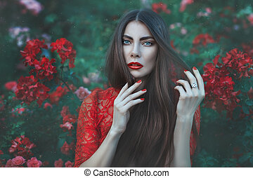 Woman among the flowers with long hair - Close-up portrait...