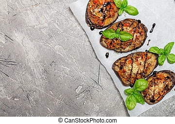 Baked eggplant stuffed with vegetables and cheese with...