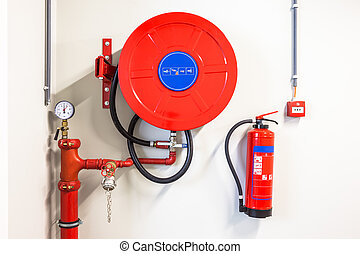 fire hose reel - an fire hose hanging on the wall and powder...