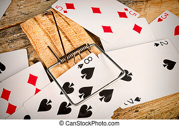 Compulsive gambling - Cards inside a mousetrap, a gambling...