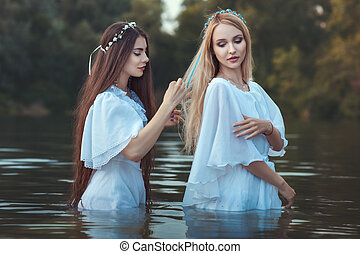 Woman doing hairstyle girlfriend. - Woman takes care of the...