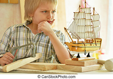 little boy working with wood - cute little boy working with...