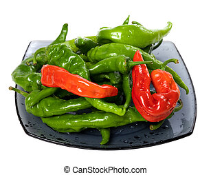 Green and red chili peppers on glass plate Isolated on white...