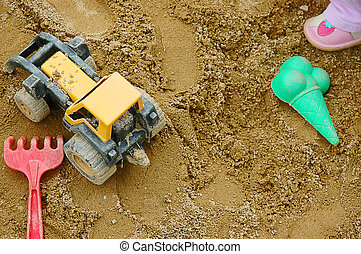 Sandpit - A sandpit with the plastic toys