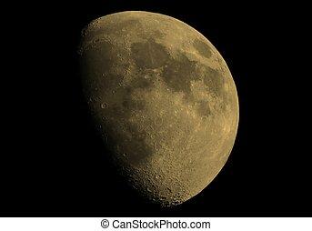 Gibbous moon sepia - Gibbous moon over dark black sky seen...