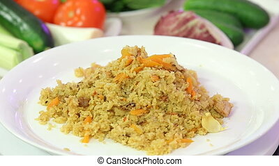 Asian pilaf - rice with meat and vegetables presentation
