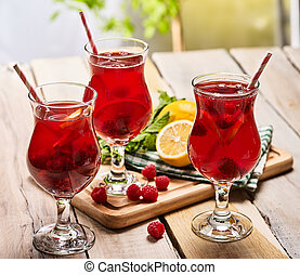 On wooden is ice cold beverage glass with berries cocktail ....