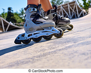 Girl riding on roller skates - Roller skate close up in...
