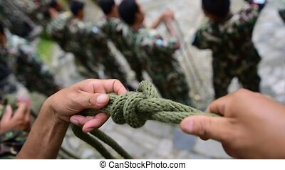 Man tying a knot
