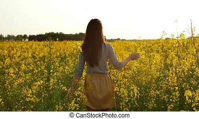 girl walks through field, straightens hair slow mo - young...