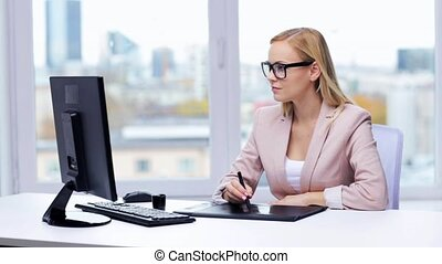 businesswoman or designer drawing with pen tablet -...