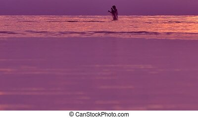 Philippines Fisherman in the sea with fishnet in sunset...