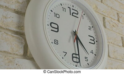 Time four hours thirty minutes. Timelapse. Round white clock...
