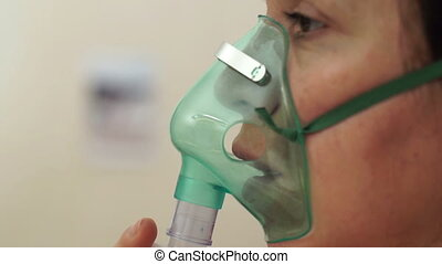 Medical Nebulizer Breathing Mask - Close up side shot of a...