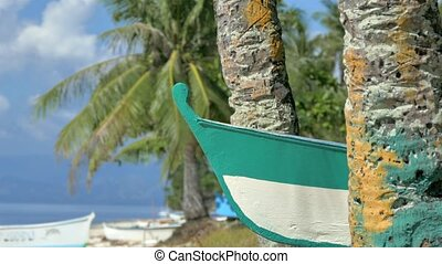 Tropical beach with boat, palm trees, blue sky and white...