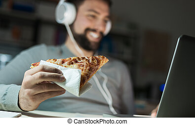 Man dining at home and networking - Man at home eating a...