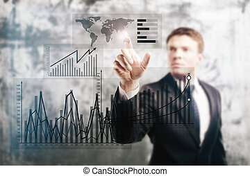 Businessman pointing at business graphs - Businessman...