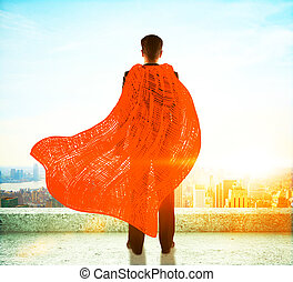 Businessman with red superhero cape standing on roof and...
