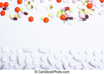 White surface with pills - Light background with colorful...