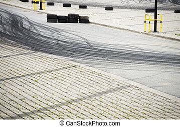 Tyre burnout marks on asphalt road