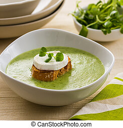 Watercress soup - A bowl of watercress soup, garnished with...
