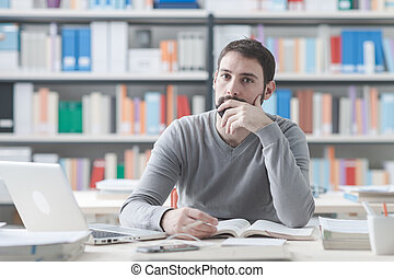 Self improvement - Young man sitting at office desk and...