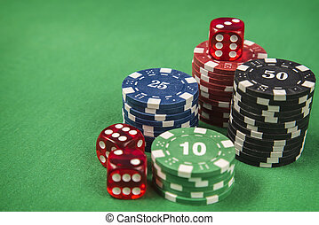Gambling chips and poker card on green felt background