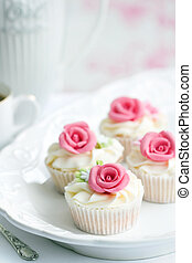 Rose cupcakes served on a white plate