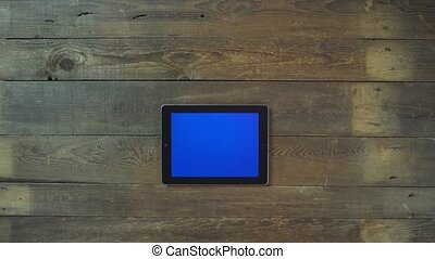 Swipes Left Hand Digital Tablet with Blue Screen - Man Hand...