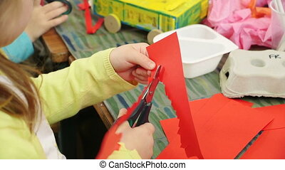Little Girl Cutting Paper - Little girl at nursery cutting...