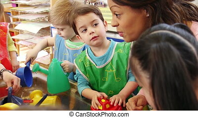 Having fun at nursery - Nursery children playing at the...