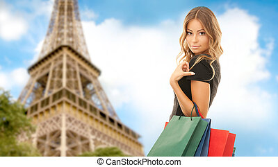 woman with shopping bags over paris eiffel tower - people,...