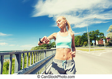 smiling young woman running outdoors - fitness, sport,...