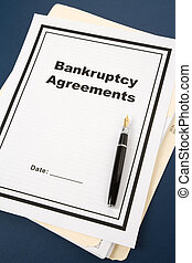 Bankruptcy Agreement and pen, business concept