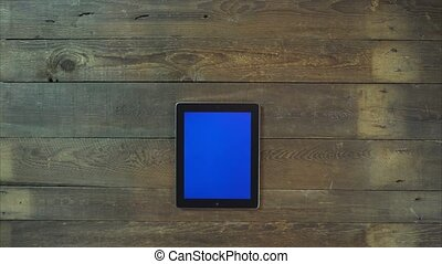 Swipes Up Hand Digital Tablet with Blue Screen - Female Hand...