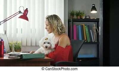 Office Woman Holding Dog During Skype Conference Call -...