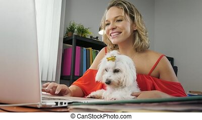 2-Business Woman Holding Dog During Skype Conference Call -...