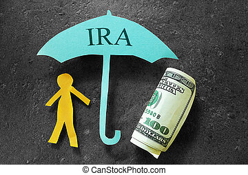 IRA savings - Paper person under an IRA umbrella with cash