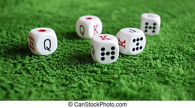 Poker dice - Five dice to play poker on a green baize