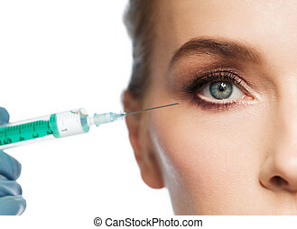 woman face and hand with syringe making injection - people,...