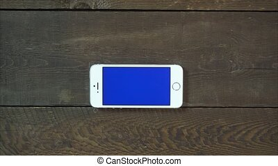 Swipes Up Hand Smartphone with Blue Screen - Man Hand Using...