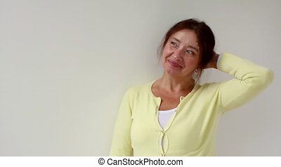 Portrait of happy elderly hispanic lady smiling