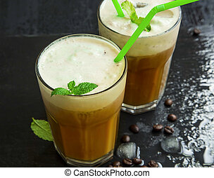 Iced frappe coffee with mint leaves