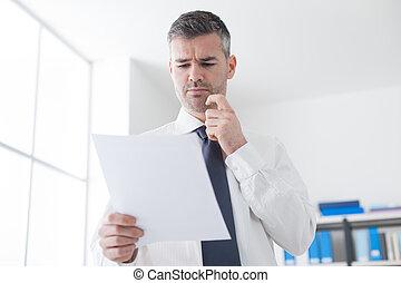 Businessman examining bills