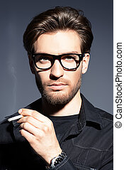 handsome smoking man - Attractive young man thoughtfully and...