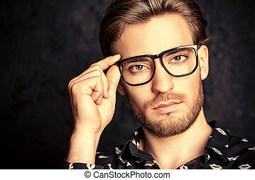 glasses style - Imposing young man in spectacles. Men's...